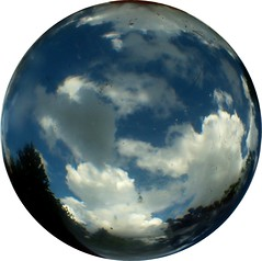 a patch of blue sky (april-mo) Tags: sky clouds ciel sphere round crystalball spheric experimentaltechnique crystalballphotography nonopticalglass