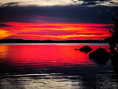 Kukkia Sunset 2 (Chrisseee) Tags: sunset red sky lake reflection birds finland evening rocks horizon burning kukkia