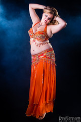 Smoky Dance (Paul Cory) Tags: lighting camera portrait people orange woman color hair studio lens dance smoke dancer bellydance reflector strobe blondhair canoncamera alienbees sigmalens radiotrigger canon60d geocity silverreflector camera:make=canon hairandeyes exif:make=canon exif:iso_speed=400 exif:focal_length=24mm alienbees800 canon430exii canonstrobe geostate geocountrys exif:lens=2470mm exif:aperture=80 camera:model=canoneos60d exif:model=canoneos60d lumapro160 43inchreflector cactusv5radiotrigger sigma2470f28hsmex andaleebellydance