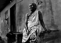 Fisherman's Home ([PKPC]) Tags: street light portrait people blackandwhite bw woman india art face contrast dark photography mono photo blackwhite interesting fishing eyes nikon exposure fishermen image noiretblanc retrato indian streetportrait naturallight portrt human soul photowalk wait chennai soulful pretoebranco tamil tamilnadu southindia faccia humanspirit bwportrait fisherwoman indianwoman enblancoynegro effigies incredibleindia pkpc bwart faceonly d7000 farbportrait nikond7000 indiabeautiful praveenkumarpalanichamy pkpcphotography pkpcwork