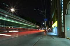 street car streaking (glenn~) Tags: street longexposure red white toronto lamp car night lights long exposure ttc queen streetcar streaks redrocket