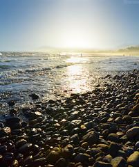 In Marbella (Alix Real) Tags: blue sky españa costa sun sol beach dawn coast spain nikon stones playa amanecer cielo reflejo malaga marbella piedras d9000