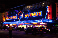 Electric Avenue, Southend-On-Sea, Essex. (EXPLORED 17-08-12 479 Thanks). (jimj0will) Tags: road street uk blue boy red summer england people signs gambling color colour cars colors sign electric night reflections fun lights amusement seaside neon traffic vibrant arcade scooter casino explore parked nightlife gamble essex southend electricavenue vibe odt vivacious immediacy explored jimj0will jimjowill