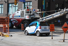 Car about to be eaten by large paving machine. (gcem32) Tags: construction grinder gazzola car2go