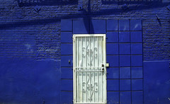 Blue Wall White Door (See El Photo) Tags: door blue shadow 15fav favorite white color wall outside outdoors alley bars colorful bright squares bricks blocks fav enter entry backdoor 1f faved