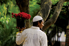 A fleeting moment (Synthia Mazumder) Tags: red redroses smile moment flowerseller fleetingmoment