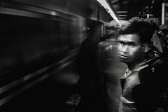 All motion is relative. Perhaps it's you who have moved away by standing still... (_MaK_) Tags: street motion monochrome train line shadow people bw candid railstation slow dhaka bangladesh