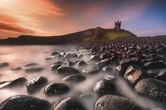 Dunstanburgh Castle (devlin11) Tags: dunstanbugh castle morning sunrise scenery seaside england water exposure rocks tranquil tower nikon magic landscape beach coast colour seascape d810