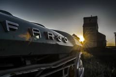 Fargo and Elevator at Sunset (Stubble Jumper Photography) Tags: grainelevator prairie truck alberta elevator fargo dodge pickup sunset lensflare