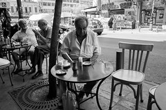 Morning in Athens (NikosAntonopoulos) Tags: bw blackandwhite athens street morning coffee greece snapshot photo photography man alone sad outdoor loneliness