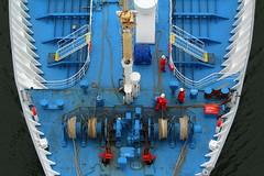 Red men on blue deck (Elbmaedchen) Tags: crew ship containership working deck winden vorderschiff bug maritim balticsea nordostseekanal kiel