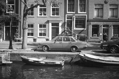 Volvo (Arne Kuilman) Tags: akarette xenon 50mm lens ilford xp2 nederland netherlands handheld c41 volvo car parked gracht canal schneiderkreuznach xenon50mmf2