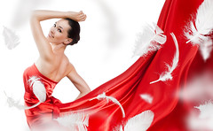 long dress (Enea Marius) Tags: female beauty dress color dancing image fashion sensuality one young woman isolated model person adult motion caucasian long glamour posing girl length human studio desire enjoyment elegance style expression performance wind carefree attractive passion red silk healthy 20s dance feather