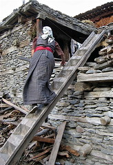 On the tibetan ladder (vittorio vida) Tags: tibet ladder people culture tradition asia houses buildings travel street
