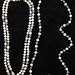 5001. Two Cultured Pearl Necklaces and Pair of Earrings