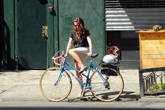 blue bicycle (omoo) Tags: newyorkcity girl smiling bicycle helmet westvillage skirt heels prettygirl greenwichvillage mounting christopherstreet bluebike dscn0898 girlmountingbicycle