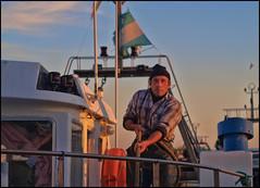 (Rafael Montes) Tags: españa costa man lens puerto 50mm boat spain barco olympus andalucia sur manual om 18 pesca litoral almeria zuiko hombre pescador vaca bou rovers rov arrastre adra e520 quillao 220posse fisman