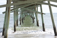 atlantic beach (peculiarnothings) Tags: ocean fish beach water pier support under salt wave structure atlantic poles underneath