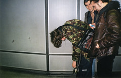Pissed up and puked on the Eastbound platform (Gary Kinsman) Tags: 2002 london film students youth drunk underground fun university young waterloo jacket camouflage laugh tubestation sick puke pissed vomit tissues jubileeline trashed lightweight bentover hunched puked