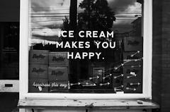 """Ice cream makes you happy"" (Eric Flexyourhead (shoulder injury, slow)) Tags: seattle wa washington usa capitolhill pinestreet eastpine eastpinestreet mollymoons mollymoonshomemadeicecream shop store window sign icecream monochrome grainy gritty highcontrastbw blackwhite bw ricohgr"