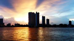 Blocks (Jean Janu Wong) Tags: outdoor sunset sunny sky urban asiatiqueriverfront bangkok thailand evening colors catchycolors orangeblue orange blocks buildings silhouette