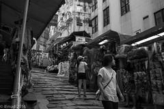 Life in Motion - Shopping at Pottinger Street... (EHA73) Tags: summicronm1228asph leica pottingerstreet leicamm hongkong travel streetphotography shopping shops blackandwhite bw typ246
