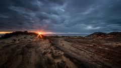 Last taste of light (--Welby--) Tags: last light fuji xt10 samyang 10mm beach coast rocks limestone sand dune clouds dark brooding blue sky sunset colour