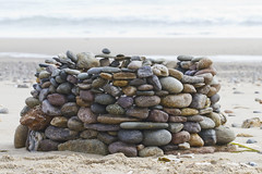 Temporary Art (brucetopher) Tags: sculpture rock pebbles stones arch turret tower beach water sea seashore rubble sand tide tidepool pool puddle colorful colors wave time passing passingoftime fragile strong momentary moment art found foundart temp creative create