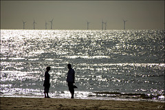 Silhouettes (Hetty S.) Tags: silhouette silhouettes beach sea holland windmills people summer waves sunshine bergenaanzee canon eos