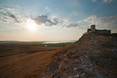 Ancient Fortress of Enisala (Dragos Cosmin- Getty Images Artist) Tags: old travel roof sea wallpaper building tower castle heritage history tourism church monument stone wall architecture vintage landscape site ancient holidays europe fort near antique citadel hill rocky medieval historic romania keep historical aged fortification strategic romanesque bastion picturesque stronghold fortress legacy remains siege battlement moldova architectonic rampart fortified feudal vestige apse patrimony dobrogea enisala