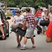 Students carry in a sofa as they move into their central campus residence hall Friday afternoon.MOVEIN.2012.1422