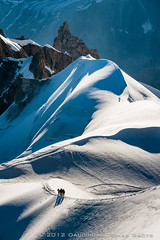 On the top of the Europe (LongLensPhotography.co.uk - Daugirdas Tomas Racys) Tags: morning light people bw white mountain snow france alps sunshine rock contrast french mono early europe bright top group descent eu first rope glacier adventure climbing tip mountaineering form tied peaks shape slippery slope alpinism 4km