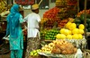 Fruit-Stall-with-couple 3058 (Harpreet Salariya Stock Photography) Tags: street india fruit couple delhi stall customer colourful 2people viewfrombehind