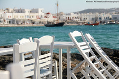Enjoying my Lunch in Mykonos Island (Meshari Al-Rezaihan) Tags: travel blue sea summer vacation sun white canon table fun boats island restaurant europe chairs greece mykonos whitehouses 550d meshari lens18200mm canon550d alrezaihan