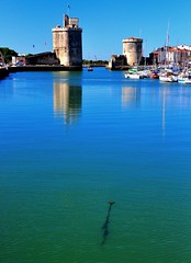 La Rochelle, France (natureloving) Tags: sea france reflection tower nature nikon harbour larochelle d90 natureloving
