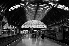Paddington Station [Explored] (The_Kevster) Tags: leica roof light people blackandwhite bw london glass monochrome station architecture train reflections iron arch shadows wroughtiron railway rangefinder landmark passengers paddington coaches westlondon brunel carriages gwr isambardkingdombrunel greatwestern summicron50mm leicam9