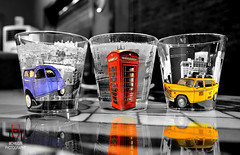 Glass Street! (Hassan Mohiudin) Tags: street bw cars glass booth phone colourful removedfromstrobistpool nooffcameraflash seerule1