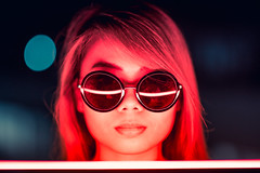 Dirty Shades (Jon Siegel) Tags: nikon d810 nikkor 85mm 14 nikon85mmf14afd woman sunglasses shades girl beautiful youth night evening neon portrait reflections chinese singapore singaporean people rooftop