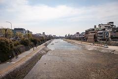 kyoto-2746 (yukkycakes) Tags: kyoto japan kamogawa kamoriver water river cobblestones buildings restaurants trees bikes bicycles truck