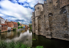 Moat at the Castle in Ghent, Belgium (` Toshio ') Tags: toshio ghent belgium gravensteen castle moat medieval water reflection europe european europeanunion clouds history fujixe2 xe2