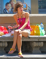 Lunch on a bench (chrisk8800) Tags: barcelona street city light shadow vacation portrait people urban woman holiday girl face lady female bench lunch lumix nice model eyes pretty legs sandals candid young streetphotography streetlife tourist panasonic attractive visitor appealing brown street photography hair