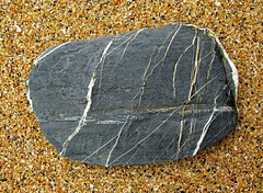 Stone on Sand IV (Peter Lovelock) Tags: sea rock stone grey bay seaside sand cornwall stones tide grain peter strata granite inlet tidal lovelock g9 canonpowershotg9 powershotg9 peterlovelock peterlovelockcom
