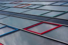 2408 - edge transition (trashpater) Tags: blue red orange colour reflection building green window glass architecture germany sony edge frame 50 facility sel minimalistic friedrichshafen nex7