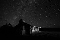 Curly's Cabin at Ghost Ranch, near Abiquiu, New Mexico (Mitch Tillison Photography) Tags: longexposure sky newmexico night stars cabin desert nighttime curly paintingwithlight abiquiu ghostranch milkyway sigma1020mm moonless pentaxk5 mitchtillison curlyscabin