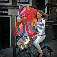 Art on a bike (Iam Marjon Bleeker) Tags: woman holland color art girl amsterdam bike bicycle painting luggage biker colourful singel bagage girlonabike womanonabike womaninamsterdam girlonabikeinamsterdam womanonabikeinamsterdam artonabike richardreggy268g2