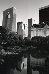 The Pond, Central Park (grshutters) Tags: newyorkcity centralpark plazahotel calvertvaux trix400 gmbuilding fredericklawolmsted sherrynetherlandhotel