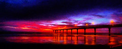 The Panorama Pier (Steve Taylor (Photography) Internet V slow) Tags: ocean red sea newzealand christchurch panorama black sunrise dawn lights coast pier twilight waves pacific jetty columns shoreline canterbury shore nz mauve southisland lamps lowtide sunup newbrighton supports blackclouds colorphotoaward