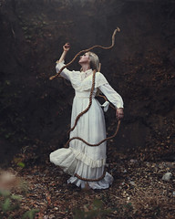 As she broke free. (David Talley) Tags: cliff brown motion texture grass wall forest vintage freedom frozen dress free rope freeze binding poisonoak vintagedress breakingfree frozenmotion texturebylesbrumes lindseymccartin