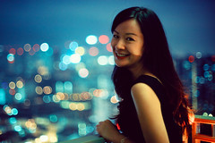 Saturday Night Portrait Time (Jon Siegel) Tags: portrait woman girl beautiful smiling skyline night 50mm lowlight nikon singapore bokeh nikkor f12 nikkor50mmf12 nikkor50mmf12ais d700