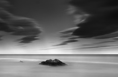 Rock and Pebble (annemcgr) Tags: longexposure sea dublin beach monochrome clouds rocks le malahide